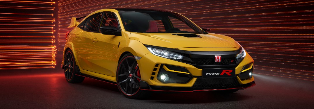 2021 Honda Civic Type R Limited Edition exterior front shot with Phoenix Yellow paint color parked in a corridor with walls decorated with red lasers