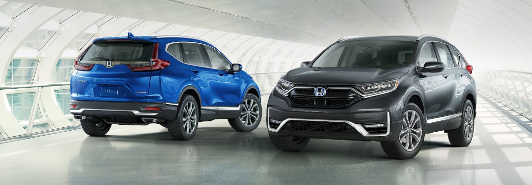 2021 Honda CR-V Touring in Aegean Blue Metallic and 2021 Honda CR-V Hybrid Touring in Modern Steel Metallic