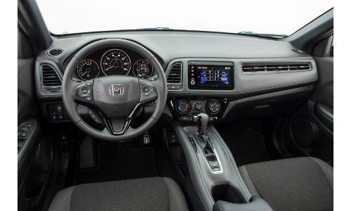2021 Honda HR-V interior shot of front seating, steering wheel, and dashboard layout