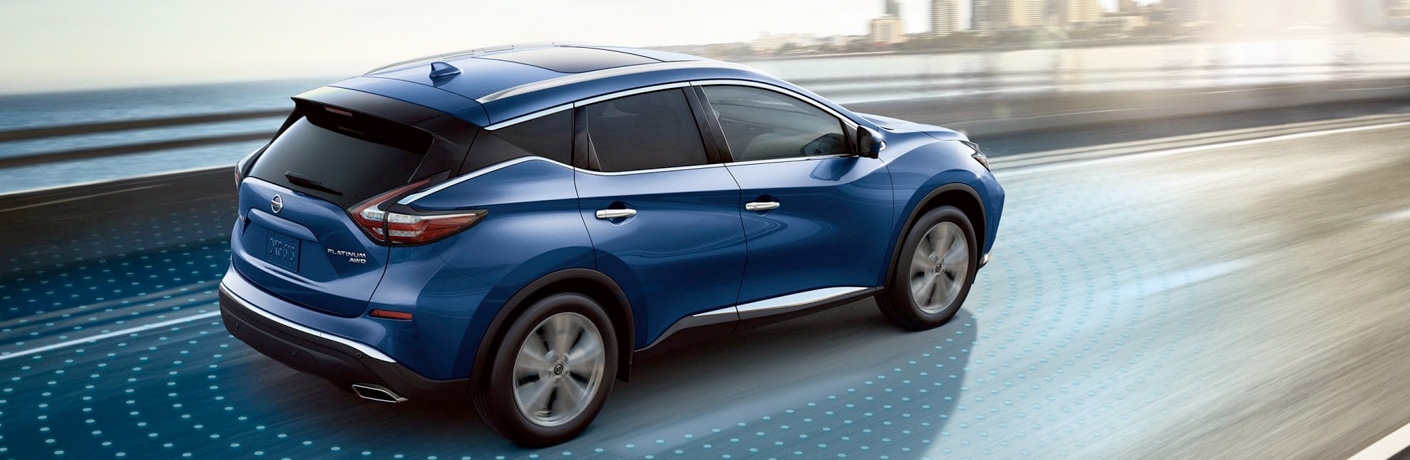 blue nissan murano on a road