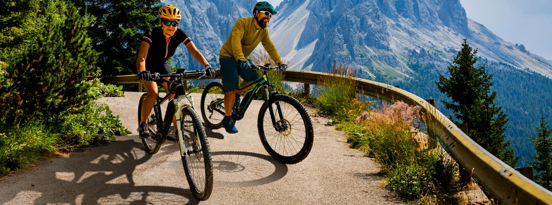 two bikers on a mountain path