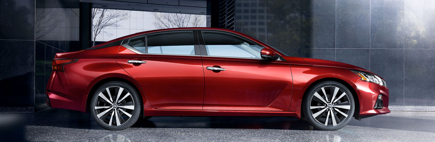 side view of red nissan altima