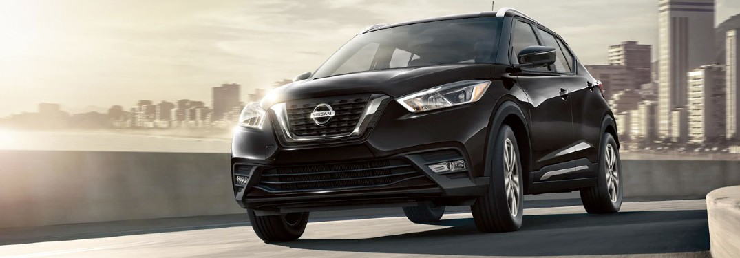 black Nissan Kicks front view on a road