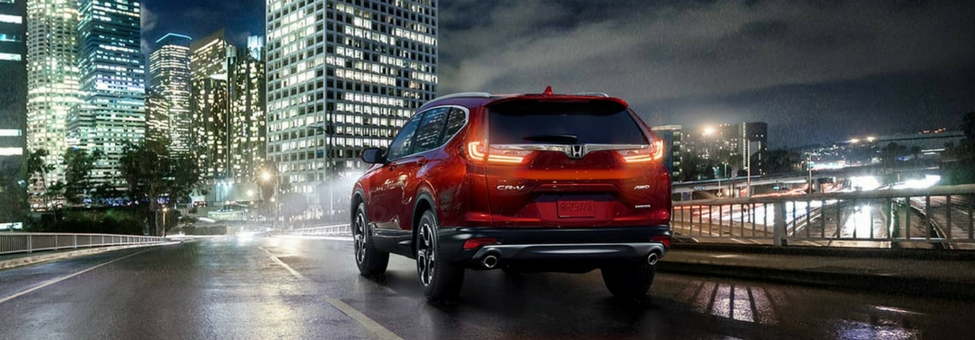 2018 Honda CR-V driving at night towards a city
