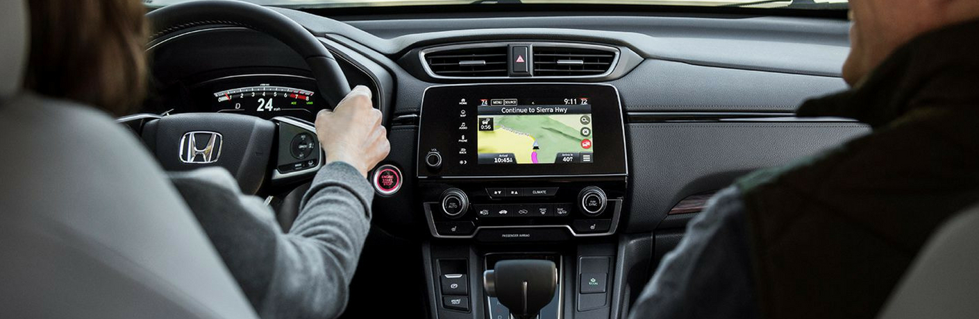 Woman and man in a car using the infotainment system on the 2018 Honda CR-V