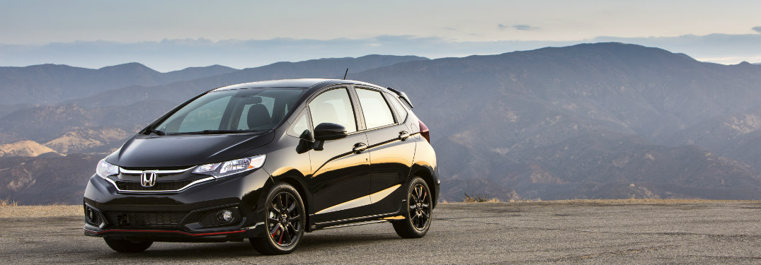 2018 Honda Fit driving down a mountain road