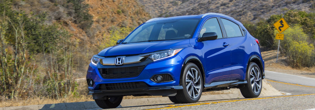 2019 Honda HR-V driving down a rural road