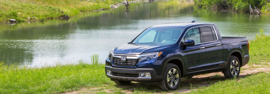 2018 Honda Ridgeline driving next to a pond