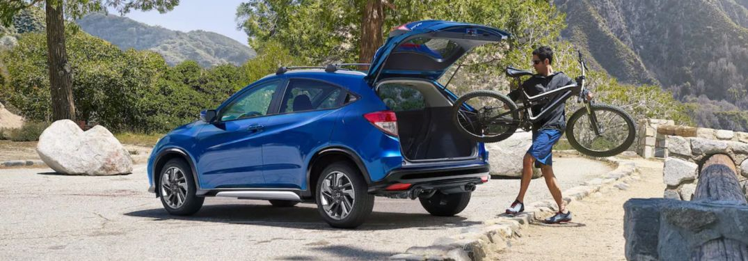 A man storing a bike in a 2019 Honda HR-V