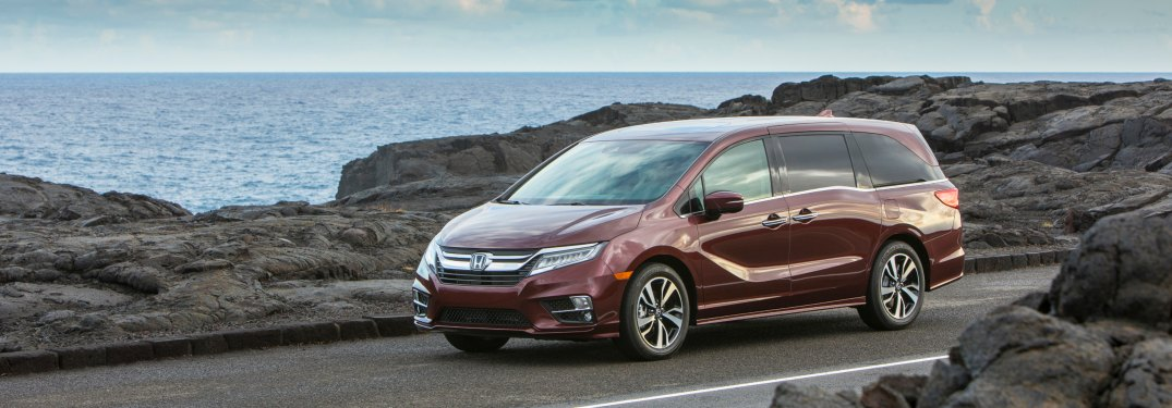 2019 Honda Odyssey driving down a road next to the coast