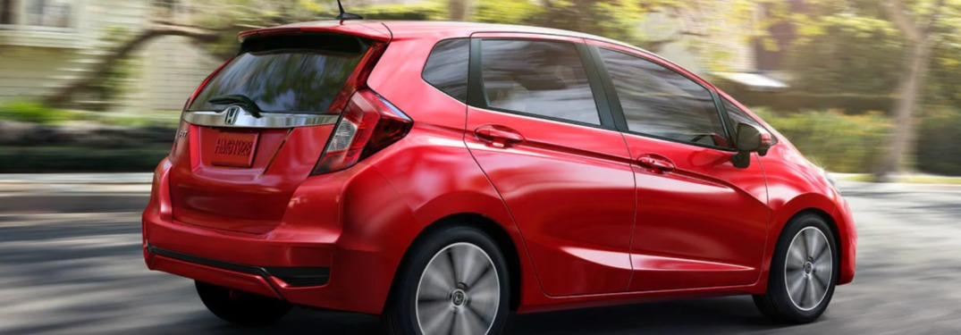 2019 Honda Fit driving fast down a road