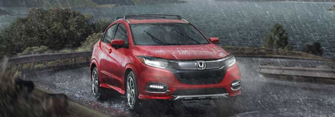 2019 Honda HR-V driving down a winding road in the rain
