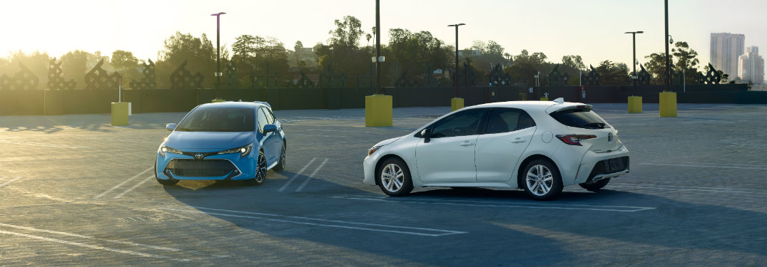Blue And White 2019 Toyota Corolla Hatchback Mdoels Parked In Lot O