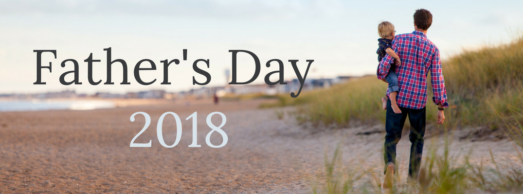 Child and father on beach with 'Father's Day 2018' text to the left