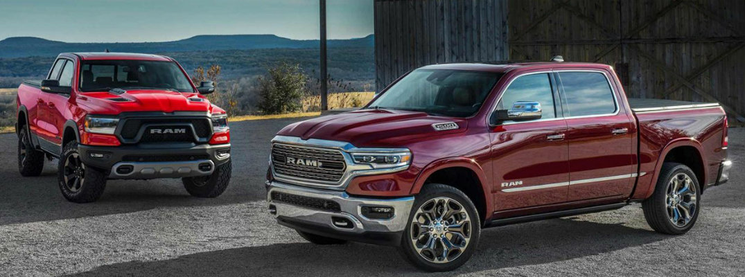 Two RAM 1500 models in different shades of red