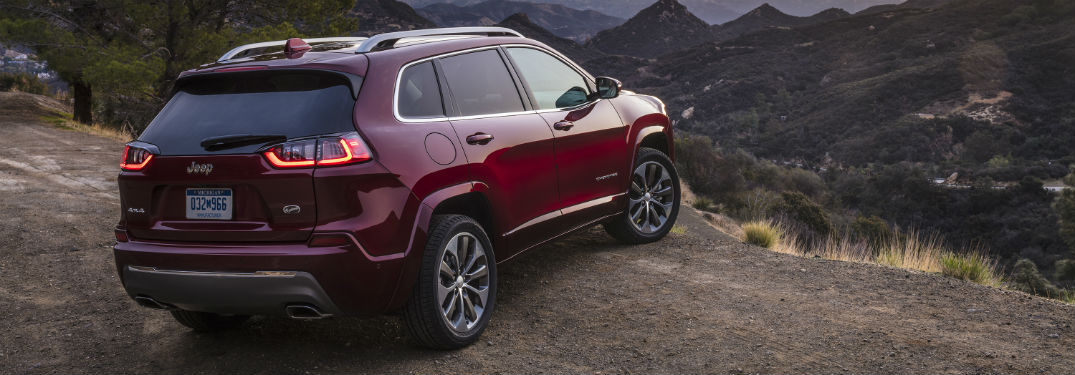 Rear passenger side exterior view of a red 2019 Jeep Cherokee