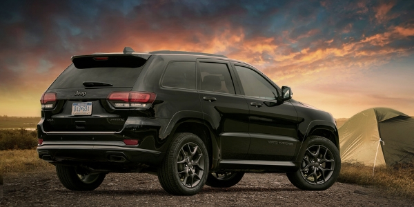 Black 2019 Jeep Grand Cherokee Limited X Rear Exterior at Campsite at Sunset