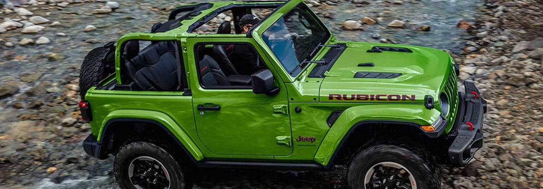 Green 2019 Jeep Wrangler Rubicon on a Rocky Trail