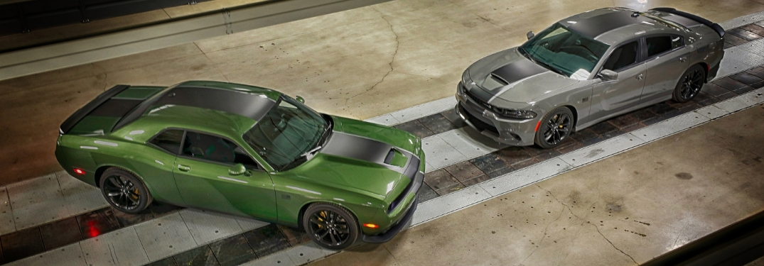 Overhead View of Green 2019 Dodge Challenger Stars and Stripes Edition and Gray 2019 Dodge Charger Stars and Stripes Edition in a Hangar