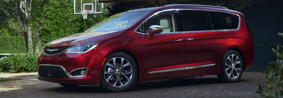 Red 2019 Chrysler Pacifica parked near a basketball court