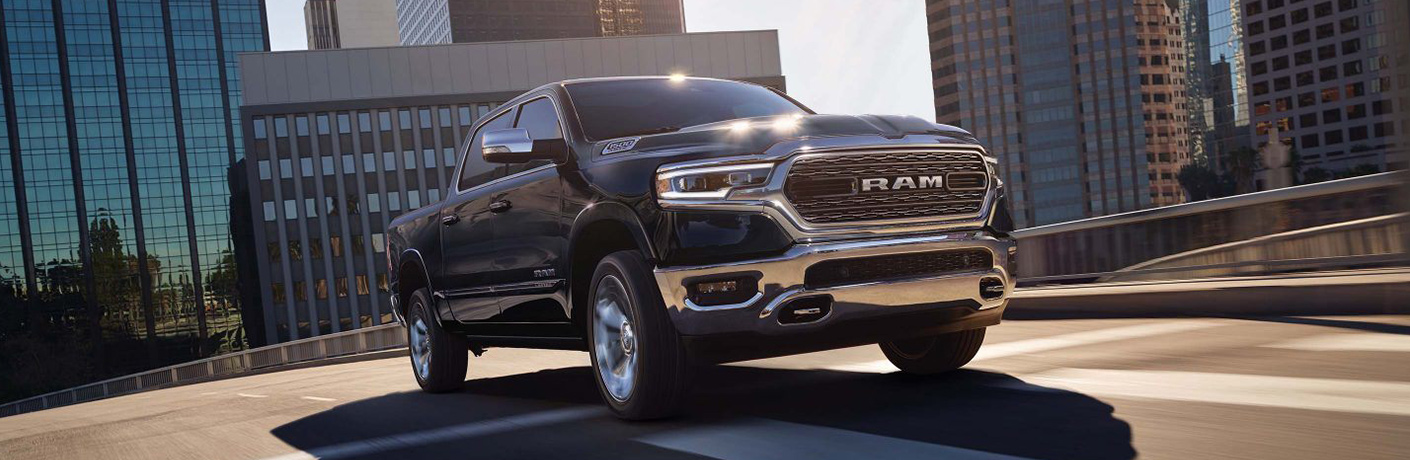 Black 2019 Ram 1500 with large buildings in the background