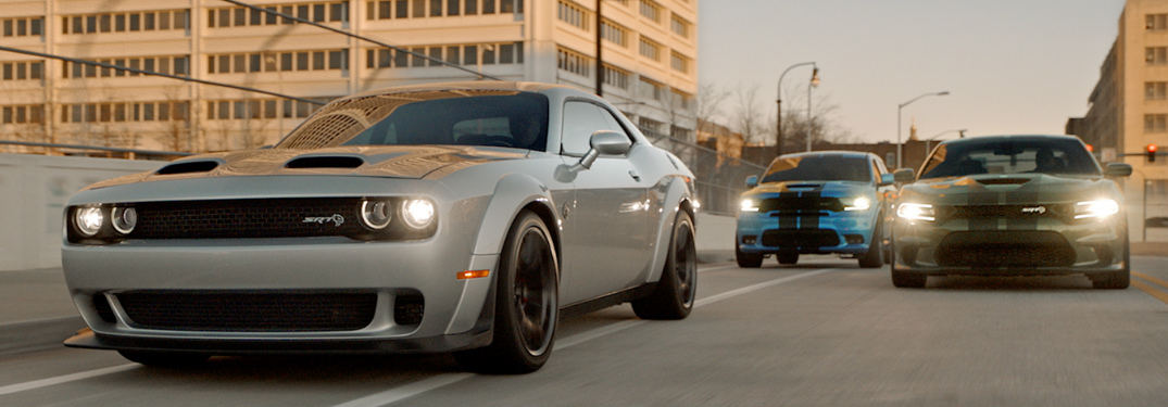 Grey 2019 Dodge Challenger, blue 2019 Dodge Durango, and green 2019 Dodge Challenger
