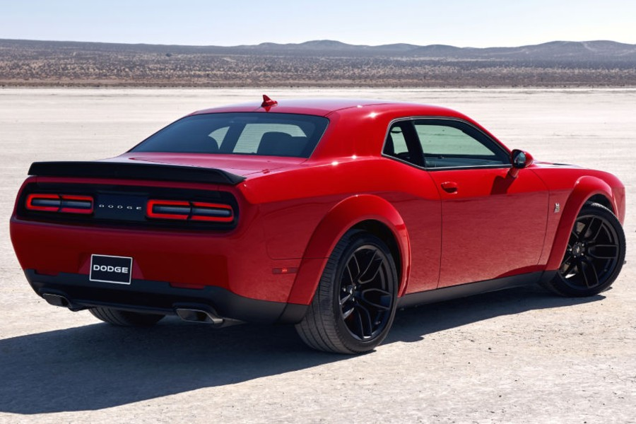 Rear passenger angle of a red 2020 Dodge Challenger