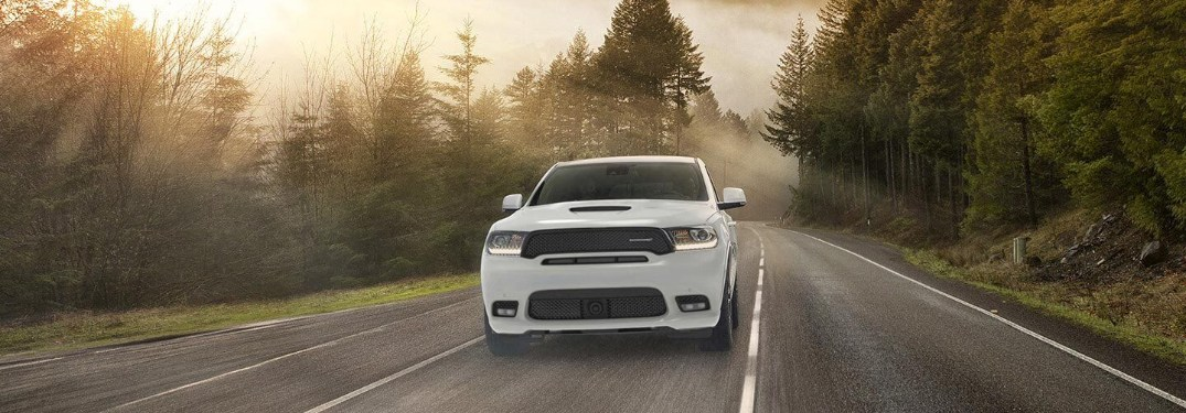 Front view of a white 2020 Dodge Durango driving down a rural road