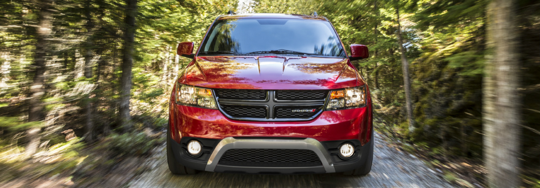 Red 2020 Dodge Journey driving through a forest