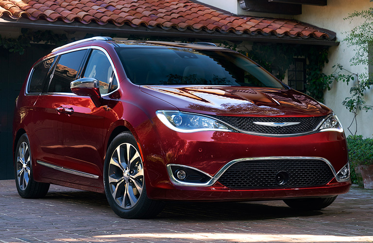 Red 2019 Chrysler Pacifica parked in a driveway