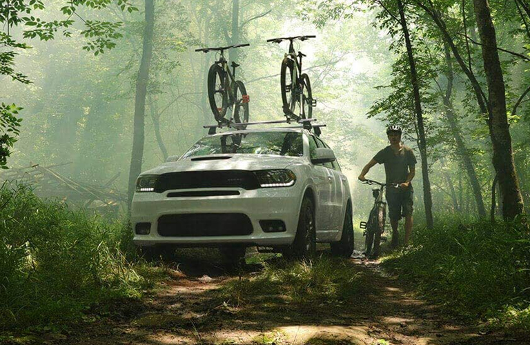 2020 Dodge Durango white with bike rack in forest