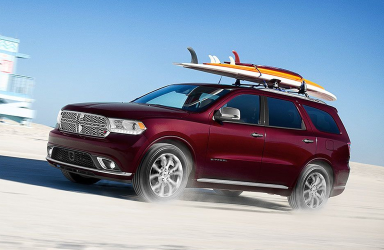 2020 Dodge Durango with surfboard on top in red