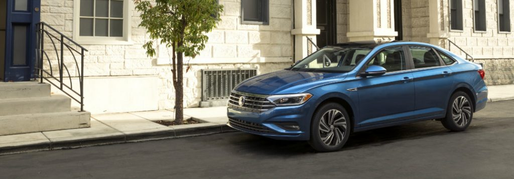 2019 volkswagen jetta parked in front of building