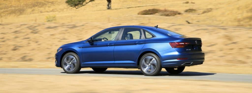 2019 volkswagen jetta rear side view while driving