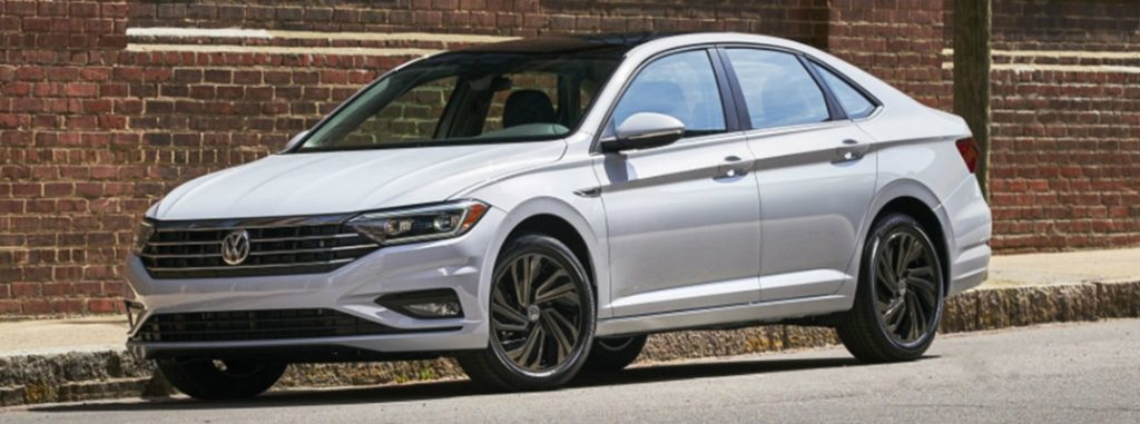 2019 volkswagen jetta white parked on street full view