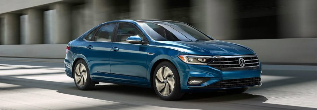 2019 volkswagen jetta silk blue metallic driving