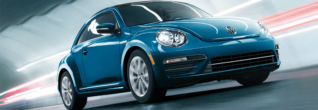 2019 VW Beetle exterior front fascia and drivers side going fast in blurred tunnel