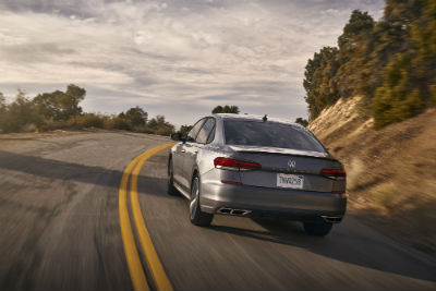 2020 VW Passat exterior back fascia and drivers side going fast on road