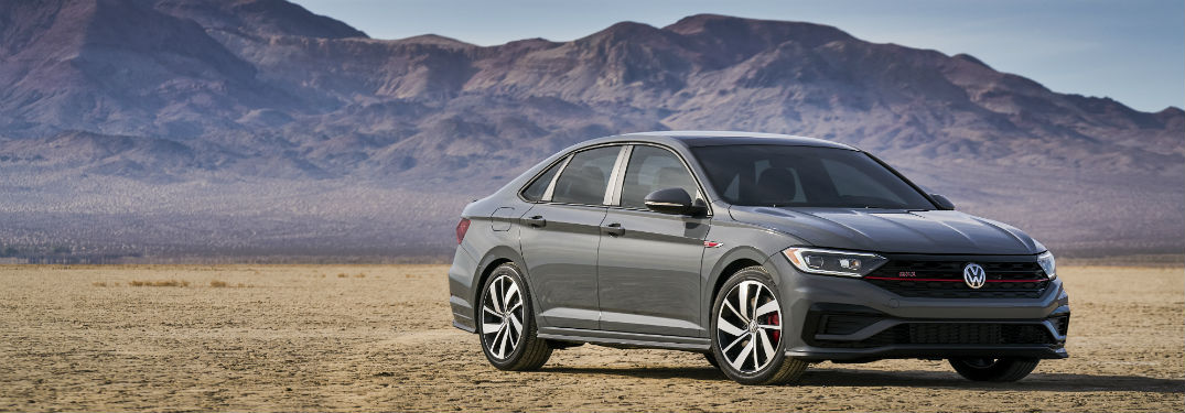 2019 VW Jetta GLI exterior front and passenger side in front of mountains