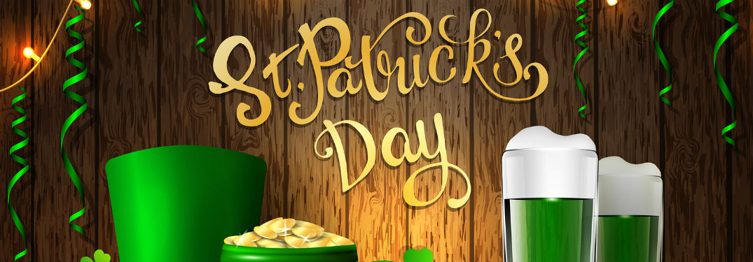 St Patricks Day banner with scrawling letters green beer and a pot of gold