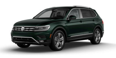 Dark Moss Green Metallic 2019 VW Tiguan exterior front fascia and drivers side on blank background