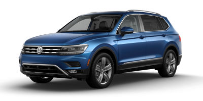 Silk Blue Metallic 2019 VW Tiguan exterior front fascia and drivers side on blank background