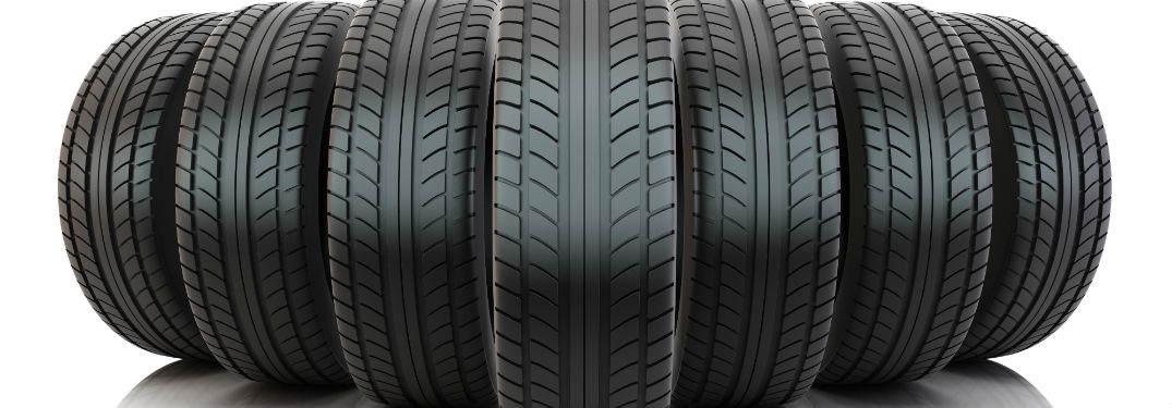 Group of tires on blank background