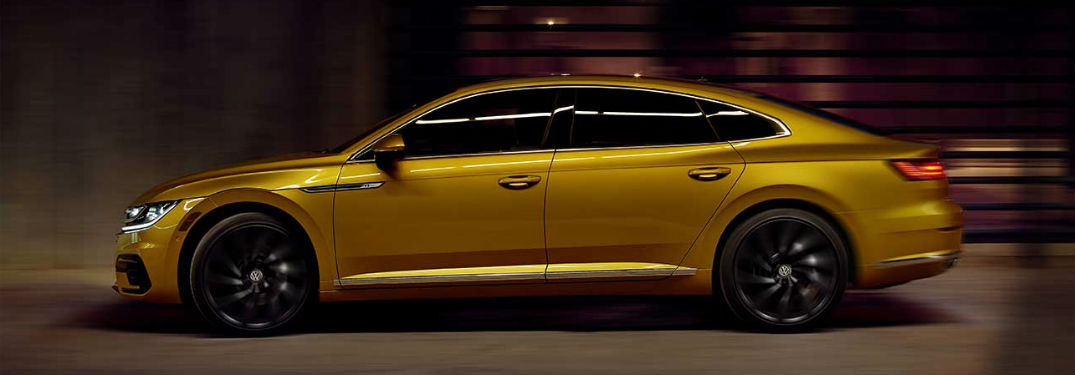 2019 VW Arteon exterior driver side in dimly lit tunnel