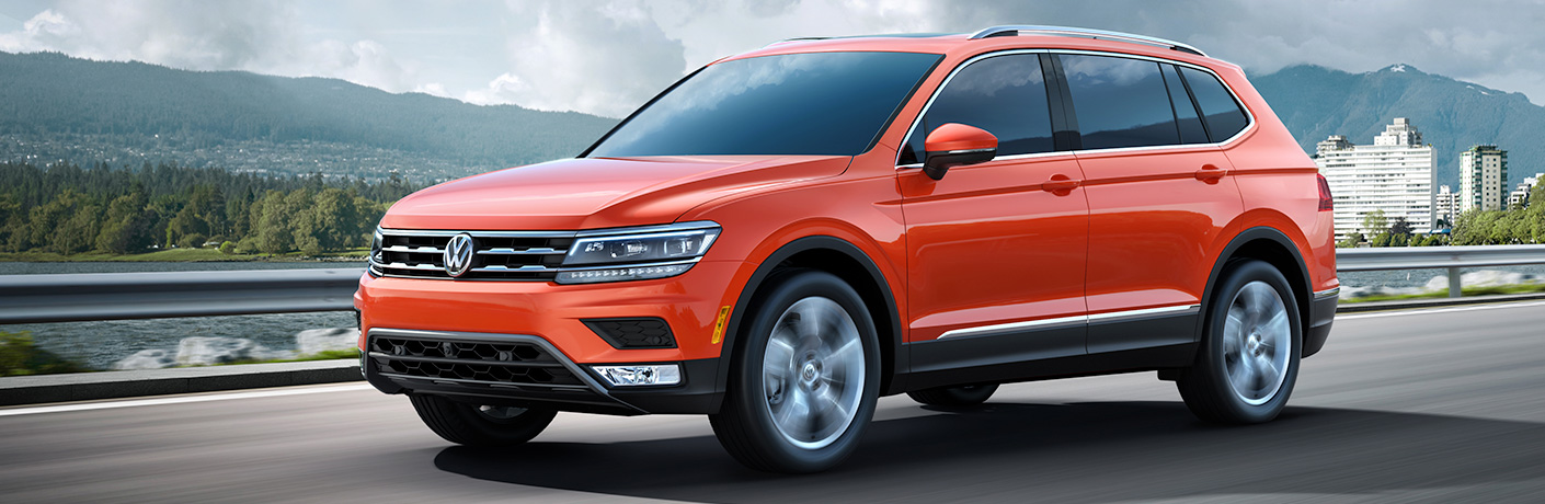 orange vw tiguan on a road