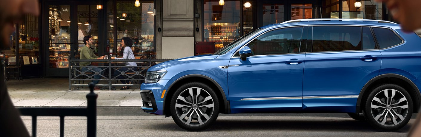 blue volkswagen tiguan side view