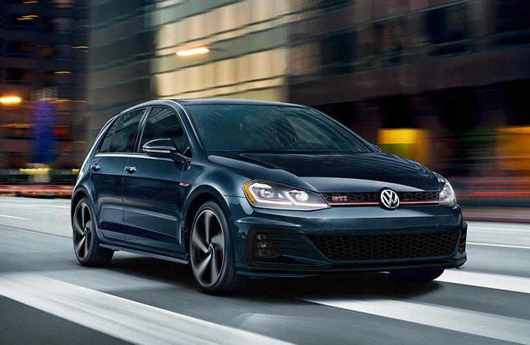 2020 Volkswagen Golf GTI driving through city