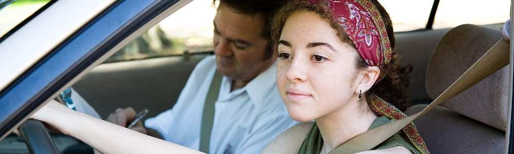 young woman taking driving lessons