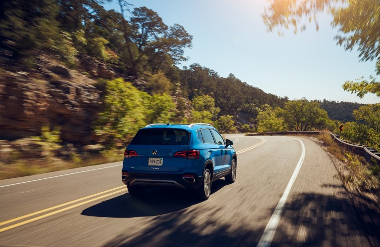 2022 Volkswagen Taos driving down the road