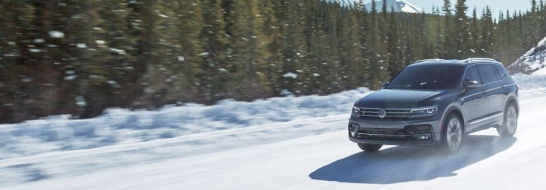 2021 Volkswagen Tiguan driving through snow